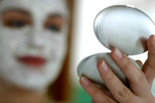 Stock Photo: 1467R-2464 Close-up of a woman holding a compact