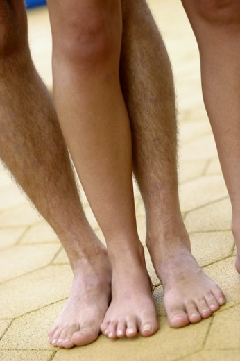 Low section view of couples legs : Stock Photo