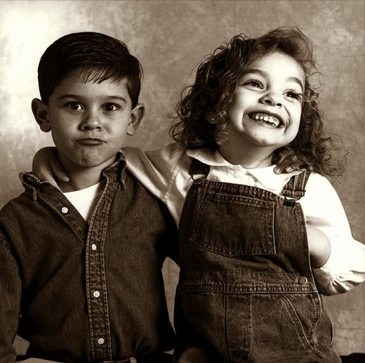Close-up of a sister smiling with her brother : Stock Photo
