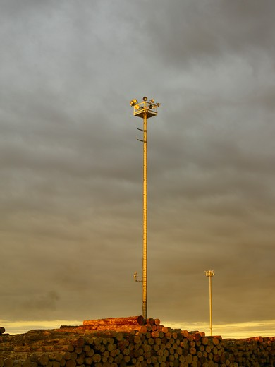 Stock Photo: 1480-557B Tall floodlights in evening at port