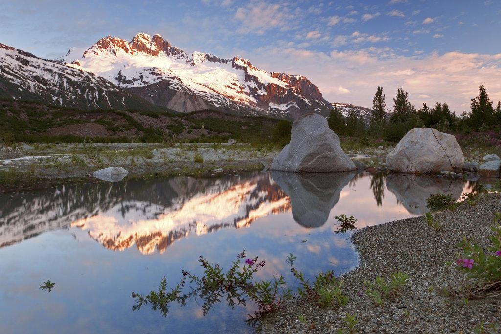 Reflection of snowcapped mountain in water, Tatshenshini-Alsek Wilderness Park, Alsek River, Alaska, USA : Stock Photo
