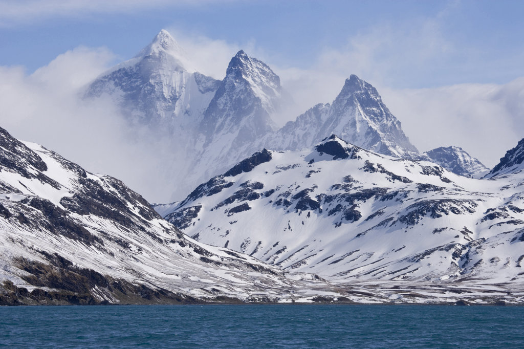 Stock Photo: 1482R-1544 Snow covered mountains at the coast, Three Brothers, South Georgia Island, South Sandwich Islands