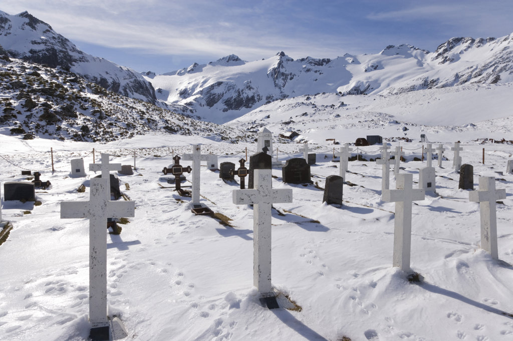 Tombstones in a snow covered cemetery, Leith Harbour, South Georgia Island, South Sandwich Islands : Stock Photo