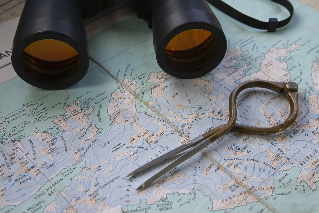 Compass and binoculars on a world map, South Georgia Island, South Sandwich Islands : Stock Photo