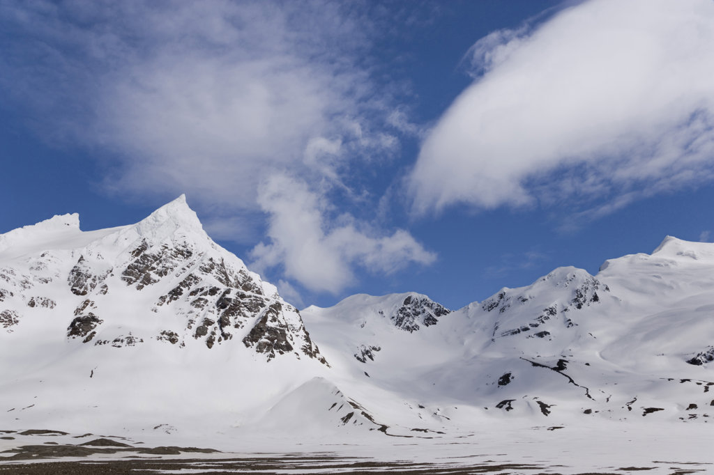 Clouds over snow covered mountains, Right Whale Bay, South Georgia Island, South Sandwich Islands : Stock Photo