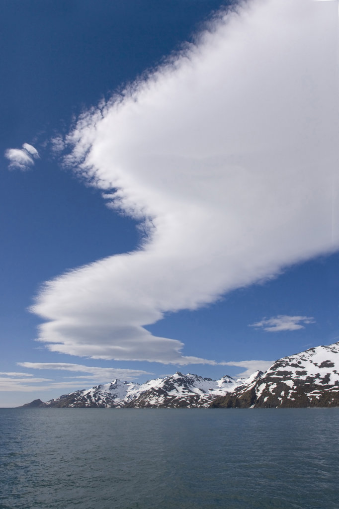 Stock Photo: 1482R-1611A Clouds in the sky with mountains in the background, St. Andrews Bay, South Georgia Island, South Sandwich Islands