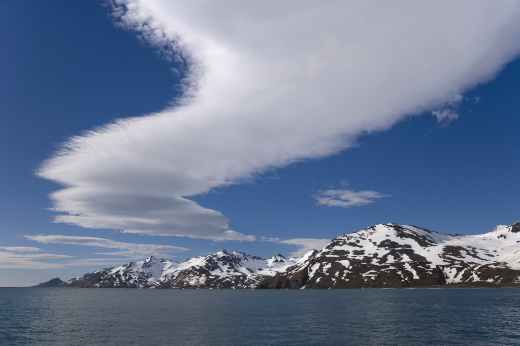 Stock Photo: 1482R-1611B Clouds in the sky with mountains in the background, St. Andrews Bay, South Georgia Island, South Sandwich Islands