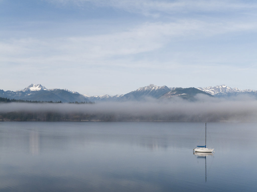 Stock Photo: 1482R-1729 Reflection of mountains in water, Seabeck Bay, Hood Canal, Seabeck, Washington State, USA