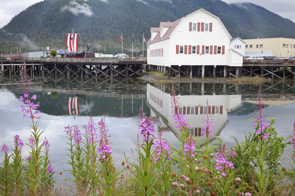 Reflection of a building in water, Sons Of Norway Hall, Petersburg, Alaska, USA : Stock Photo