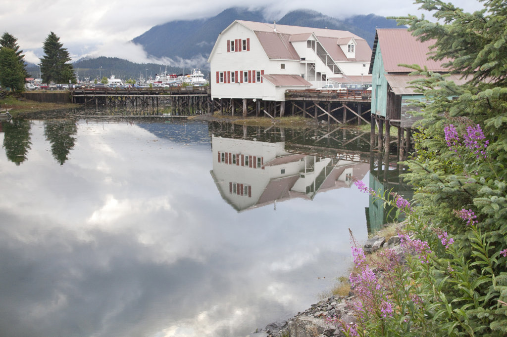 Stock Photo: 1482R-1938B Reflection of a building in water, Sons Of Norway Hall, Petersburg, Alaska, USA