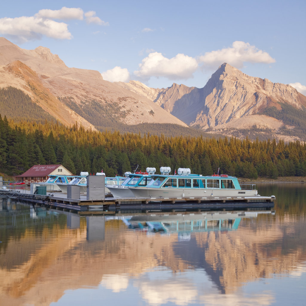 Reflection of mountains in a lake, Maligne Lake, Jasper National Park, Alberta, Canada : Stock Photo