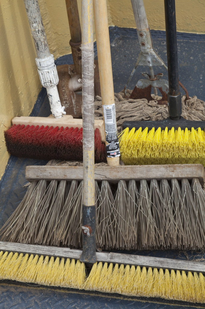Collection of brooms aboard ship : Stock Photo