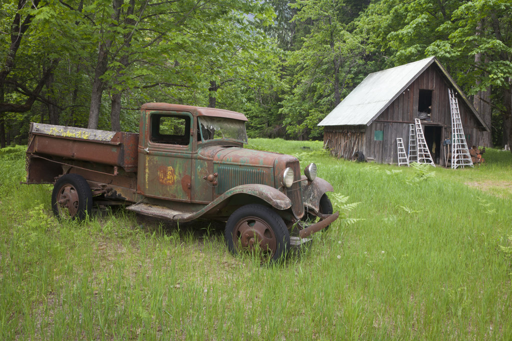 Stock Photo: 1482R-2814 USA, Washington State, Stehekin, North Cascades National Park, Historic Buckner Orchard and Homestead, Buckner Homestead Heritage Foundation, Old Rusty Truck and Barn