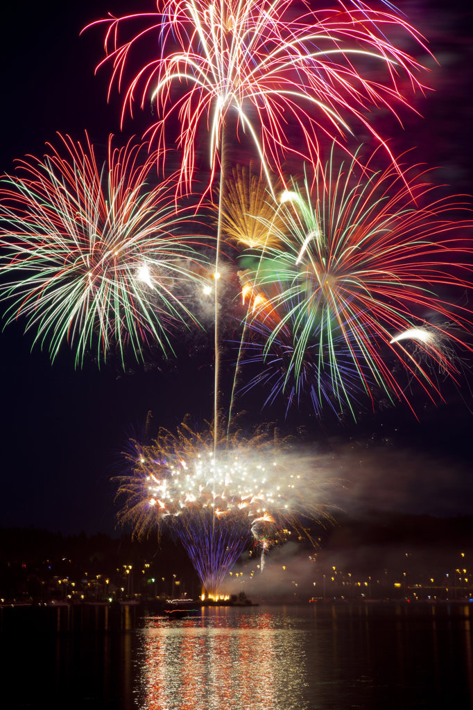 Stock Photo: 1482R-2871 USA, Washington State, Poulsbo, Fireworks Display at Night
