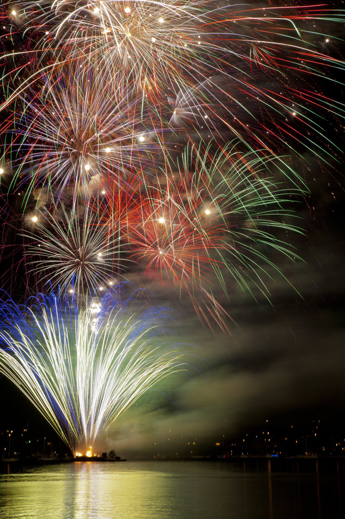 Stock Photo: 1482R-2872 USA, Washington State, Poulsbo, Fireworks Display at Night