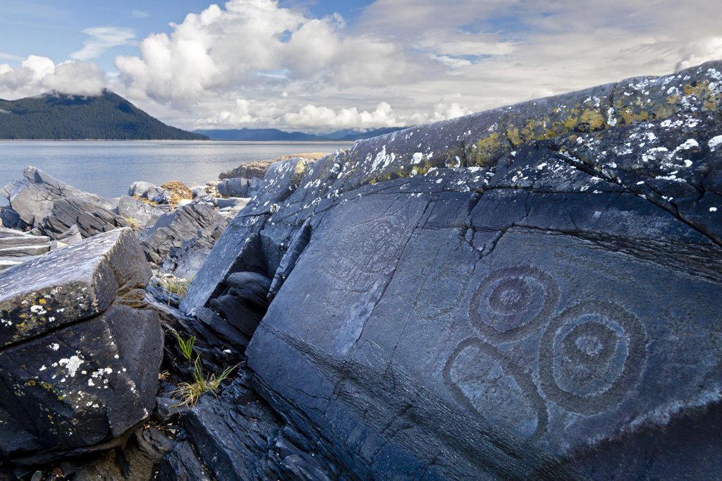 USA, Alaska, Wrangell, Petroglyph representing human face : Stock Photo