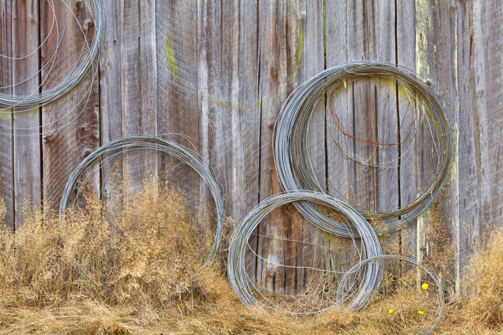 Stock Photo: 1482R-3070 USA, Washington, Silverdale, Historic Petersen Farm, Wire coiled on wall
