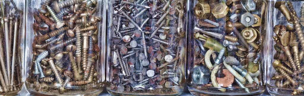 Stock Photo: 1482R-3095 Close-up of nuts and bolts with screws and nails in jars