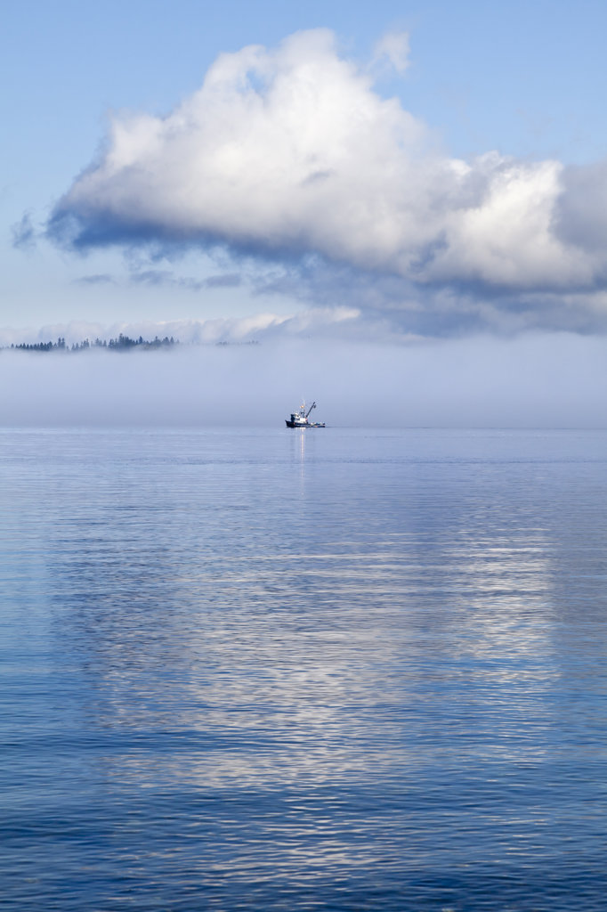 Fishing boat with morning clouds and fog in Hood Canal, Washington State, USA : Stock Photo