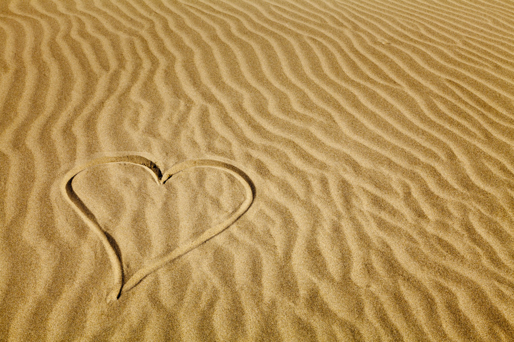 Heart shape drawn on sand on the beach, Pacific Beach, Washington State, USA : Stock Photo