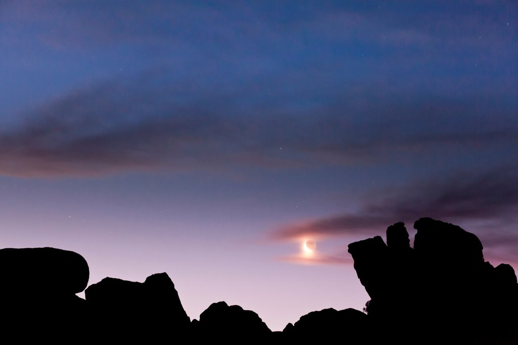 Stock Photo: 1482R-3293 USA, California, Moon and Predawn sky, Alabama Hills, near Lone Pine