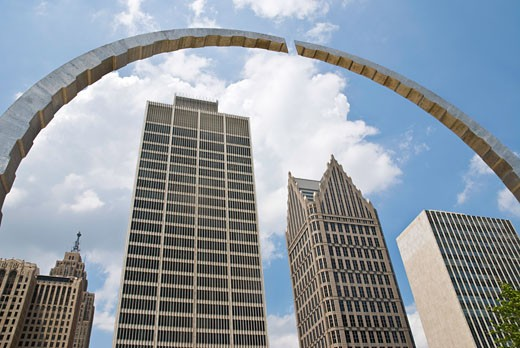 Low angle view of skyscrapers viewed through an arch sculpture, Renaissance Center, Hart Plaza, Detroit, Wayne County, Michigan, USA : Stock Photo