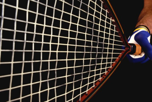 Close-up of a person holding a tennis racket : Stock Photo