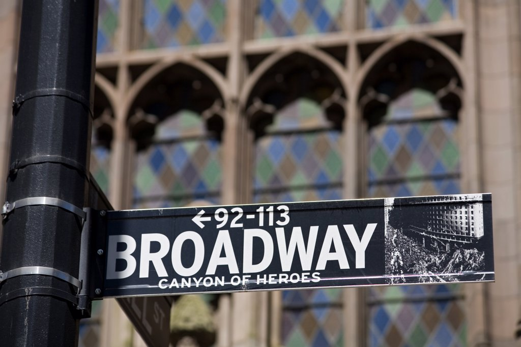 Street sign in front of Trinity Church, Lower Manhattan, New York City, New York, USA : Stock Photo