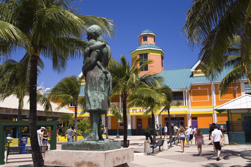 Statue in front of a colorful building, Festival Place, Nassau, New Providence, Bahamas : Stock Photo
