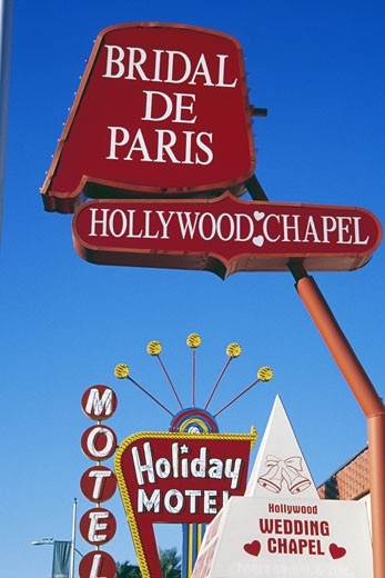 Stock Photo: 1486-1072 Wedding chapel and a motel in a city, Holiday Motel, Hollywood Wedding Chapel, Las Vegas, Nevada, USA
