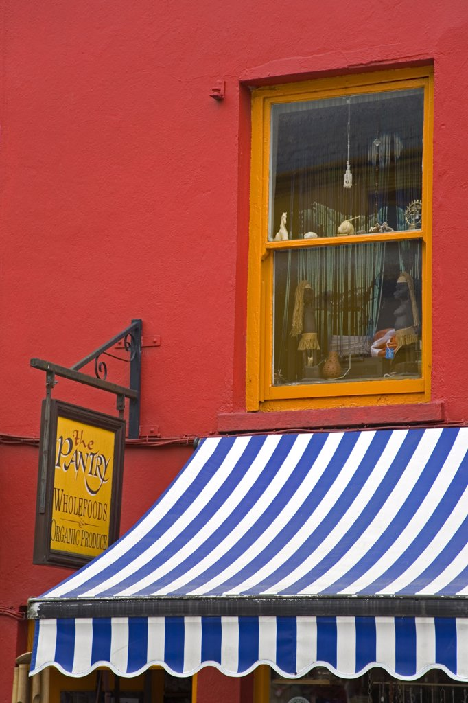 Stock Photo: 1486-10902 Store signboard hanging on a store, Kenmare, County Kerry, Munster Province, Ireland