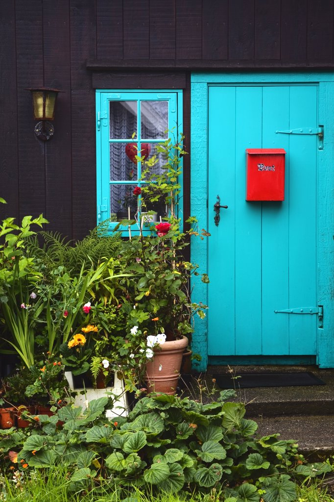Red mailbox on the door of a house, Tinganes, Torshavn, Faroe Islands, Denmark : Stock Photo