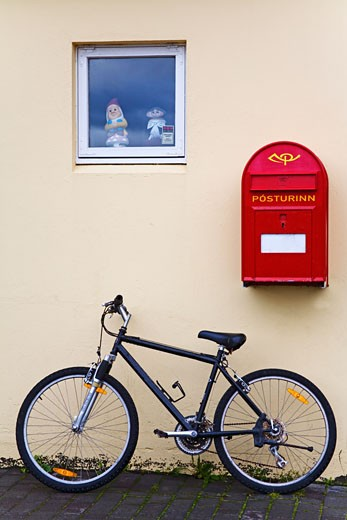 Bicycle near a mailbox, Akureyri, Iceland : Stock Photo