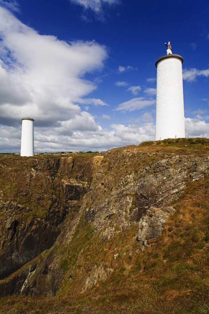 Low angle view of two beacon towers, Metal Man, Tramore, County Waterford, Munster Province, Ireland : Stock Photo