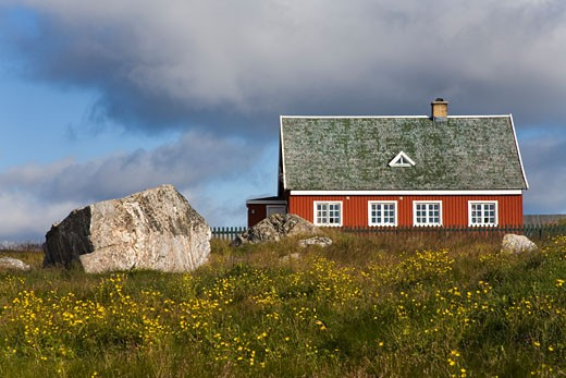 Farmhouse in a field, Nanortalik, Kitaa, Greenland : Stock Photo