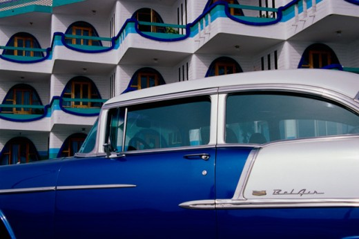 Stock Photo: 1486-1109 Side profile of a classic car parked in front of a hotel, Amigo Plaza Hotel, Mazatlan, Mexico