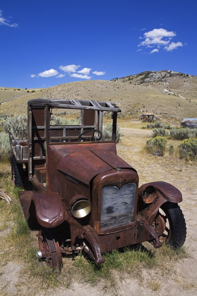 Stock Photo: 1486-11130 Abandoned truck in a field at a ghost town, Bannack State Park, Dillon, Montana, USA