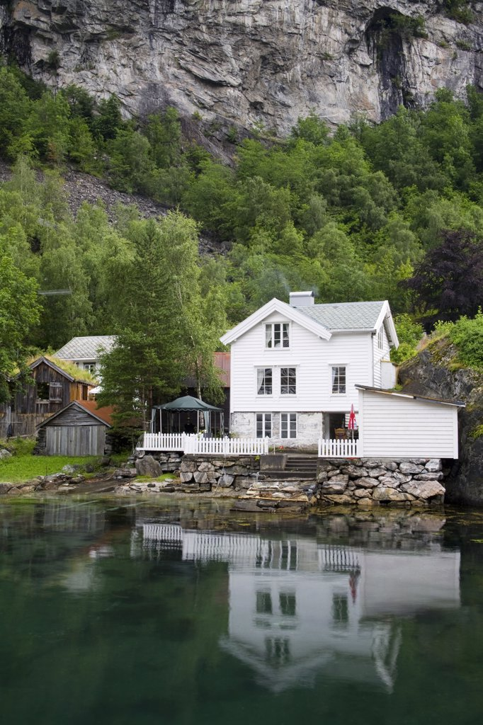 Reflection of a building in water, Geiranger, Geirangerfjord, More og Romsdal, Sunnmore, Norway : Stock Photo