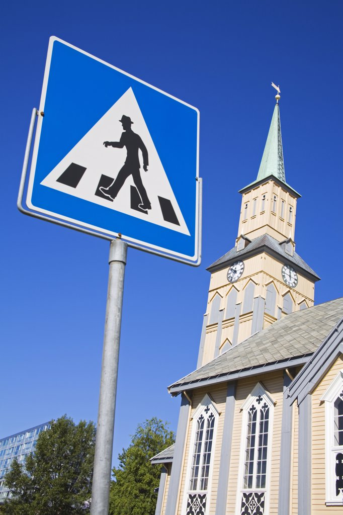 Stock Photo: 1486-11766 Pedestrian Crossing sign in front of a cathedral, Kirkeparken, Tromso, Toms County, Nord-Norge, Norway