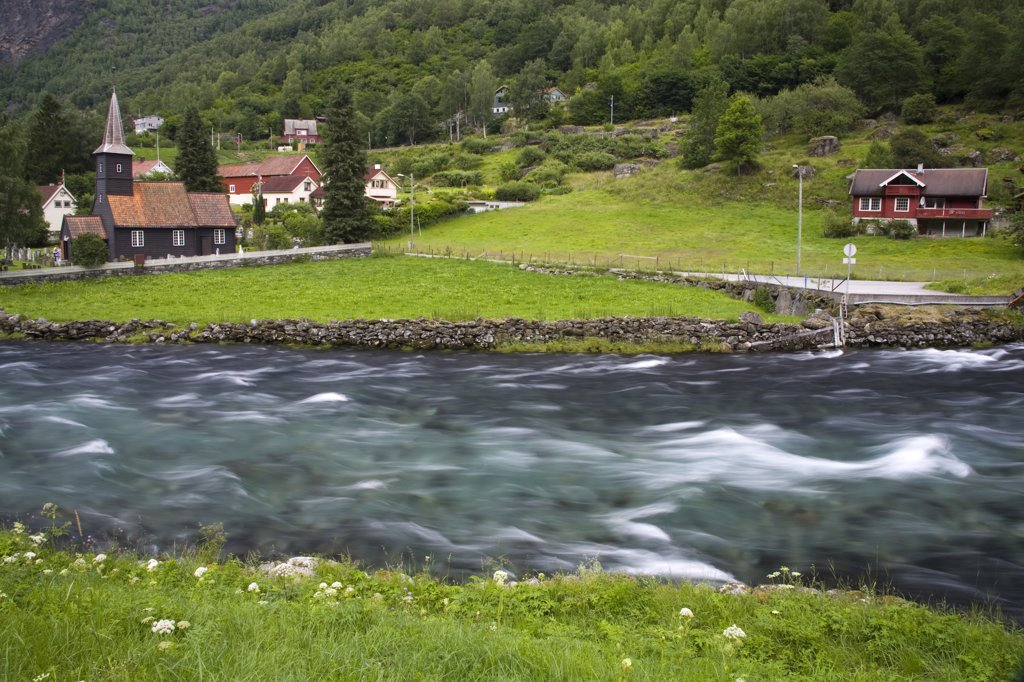 Church at the riverbank, Flam Church, Flamsdalen Valley River, Flam, Aurlandsfjord, Sogn Og Fjordane, Norway : Stock Photo