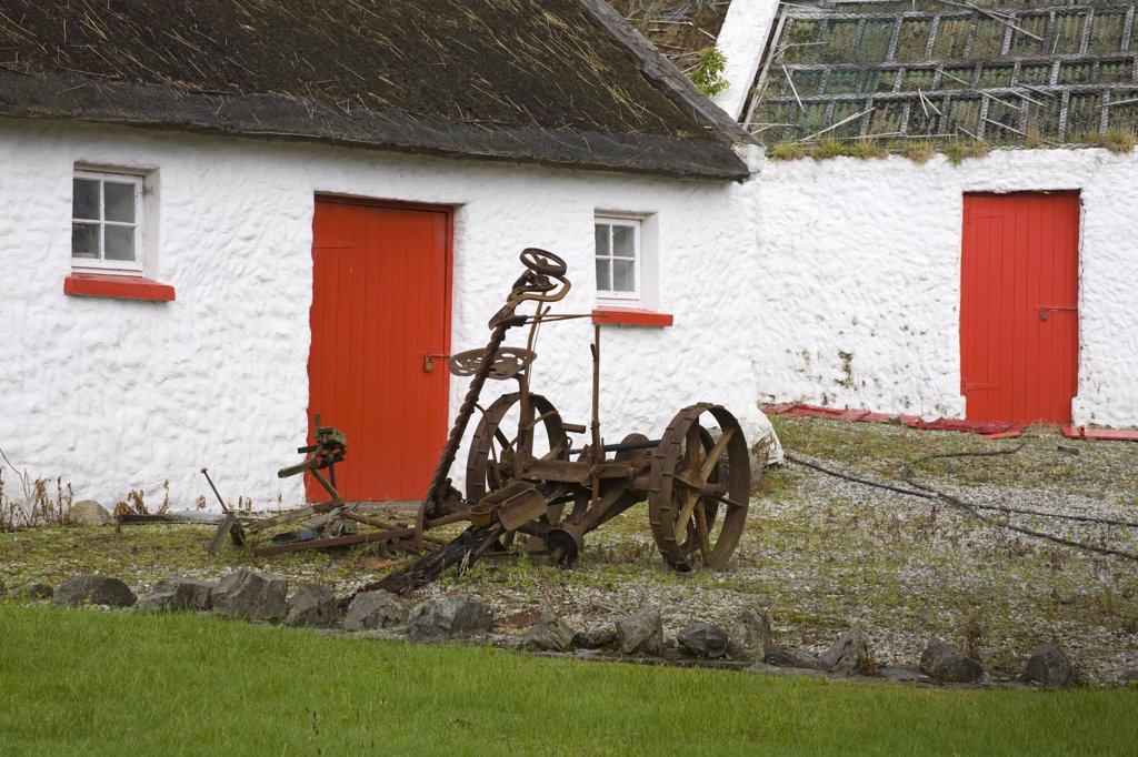 Stock Photo: 1486-11902 Abandoned cart in front of a cottage, Kilmacrenan, County Donegal, Ulster Province, Ireland