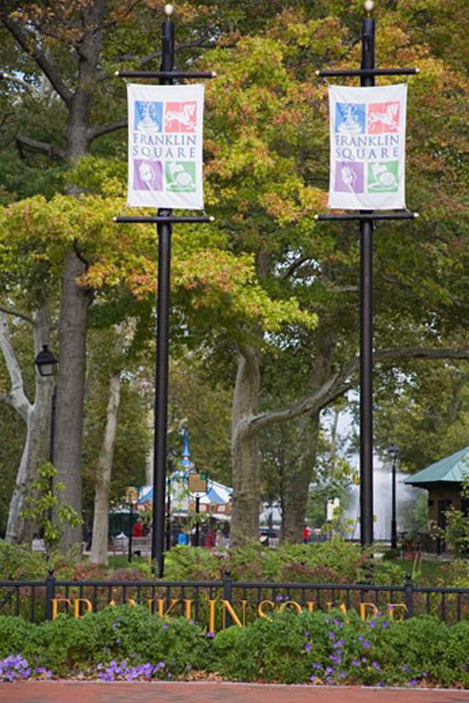 Stock Photo: 1486-12086A Signboards in a park, Franklin Square, Philadelphia, Pennsylvania, USA