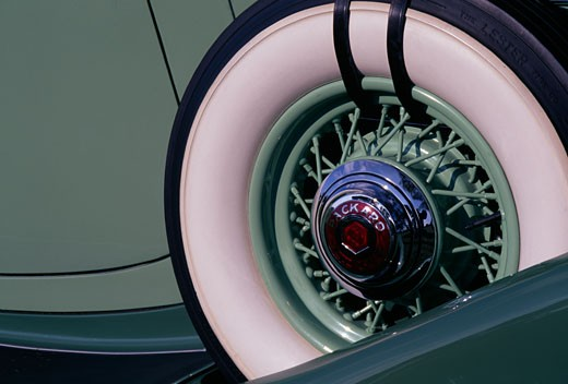 Close-up of hubcap of a Packard car : Stock Photo