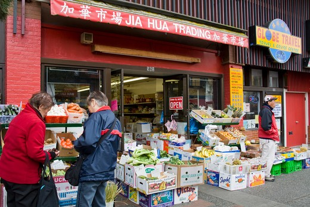 Canada, British Columbia, Vancouver Island, Victoria, Senior couple outside shop in Chinatown : Stock Photo