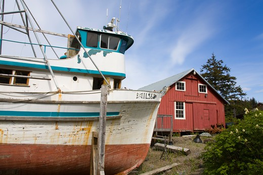 Fishing boat with a museum in the background, Cannery Museum, Icy Strait Point, Hoonah City, Chichagof Island, Alaska, USA : Stock Photo
