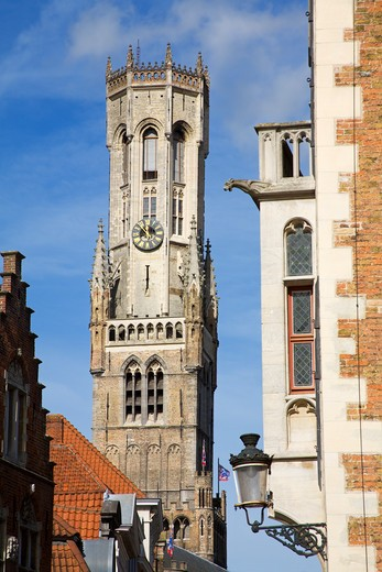 Low angle view of a bell tower in a city, Bruges, Belgium : Stock Photo