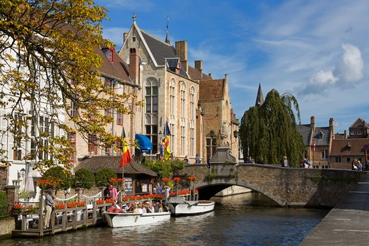 Tourboats in a canal, Bruges, Belgium : Stock Photo