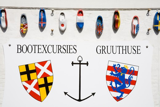 Stock Photo: 1486-13292 Clogs with national flags painted on them at a tour boat dock, Bruges, Belgium