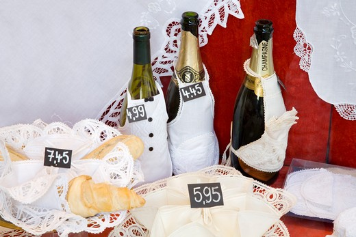 Stock Photo: 1486-13338 Champagne bottles with lace products for display in a store, Bruges, Belgium