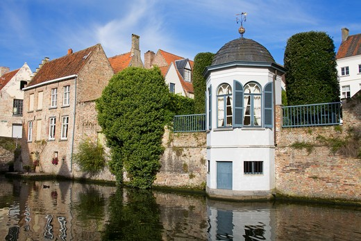 Houses along a canal, Bruges, Belgium : Stock Photo
